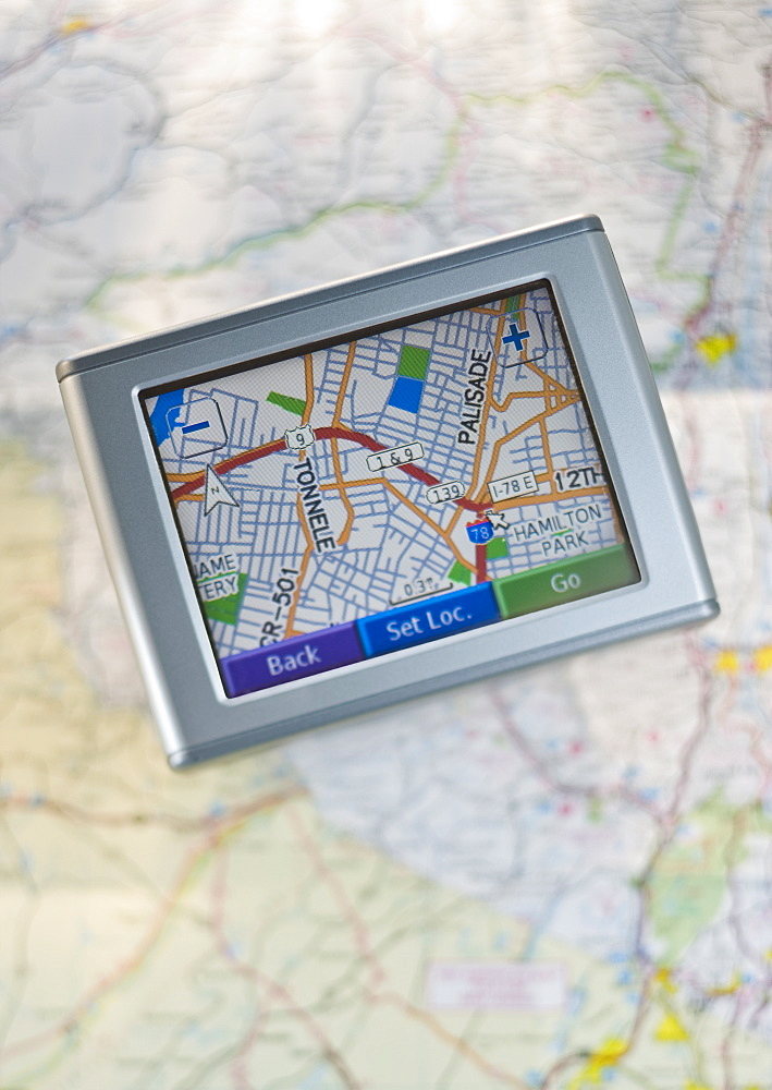 Close up of navigational system and map