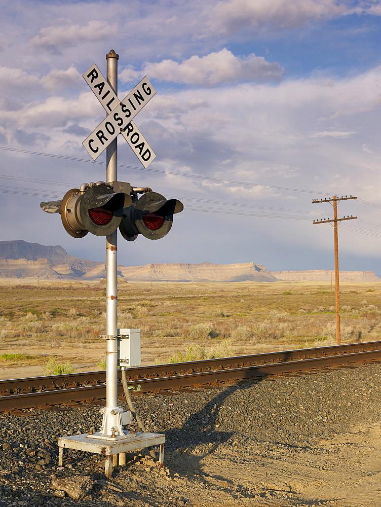 USA, Utah, Desert landscape with railroad crossing