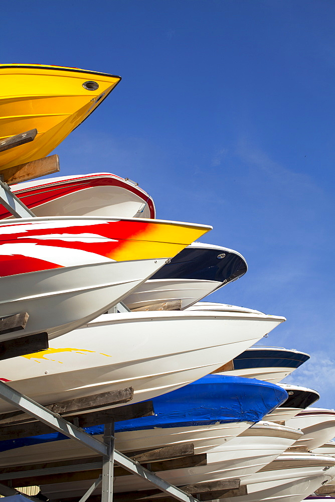 Boats stacked on rack