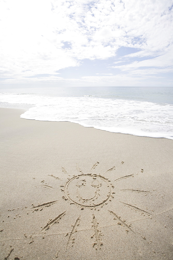 USA, Massachusetts, Sun drawn on sandy beach