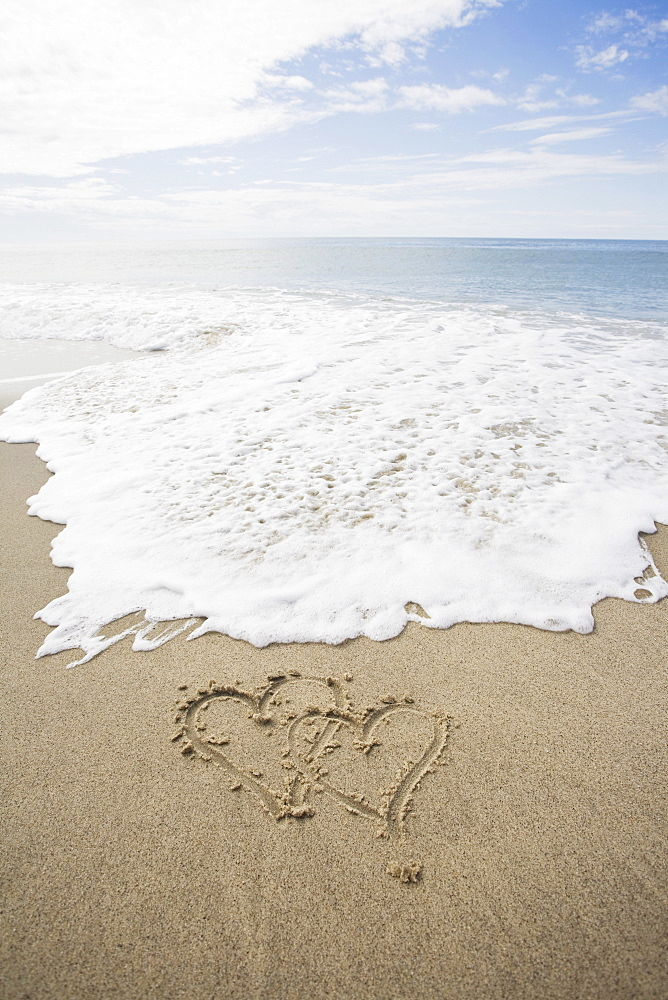USA, Massachusetts, Hearts drawn on sandy beach