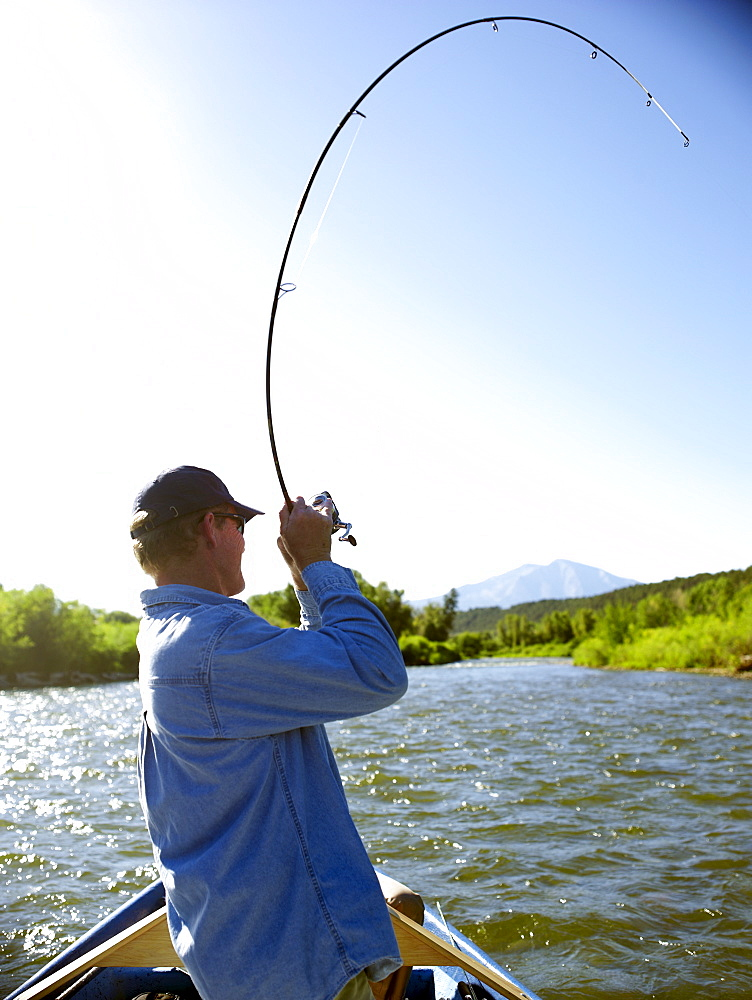 USA, Colorado, Mature man fly-fishing