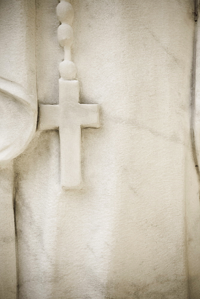 USA, Maryland, close up of cross on statue