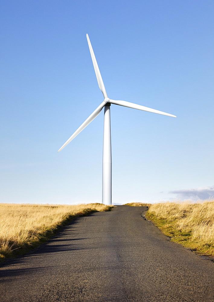 Road leading to wind turbine