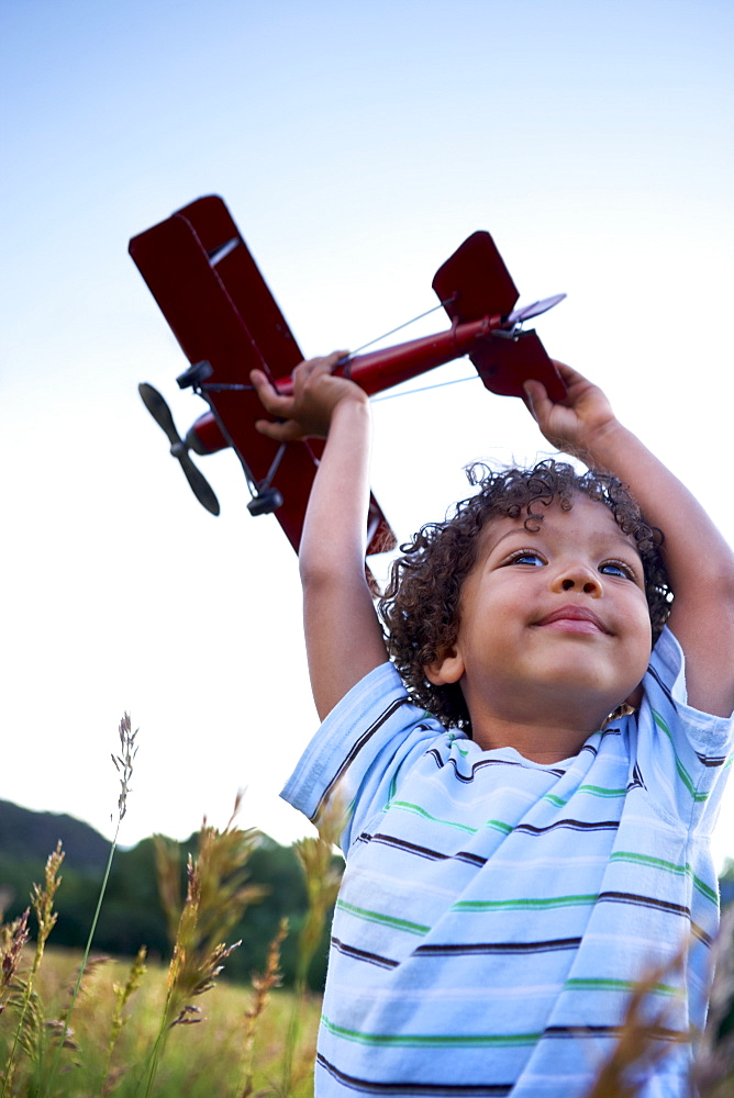 Boy (2-3) playing with toy aeroplane