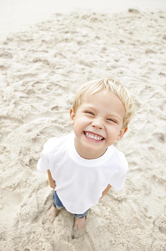 Boy (4-5) looking at camera and smiling