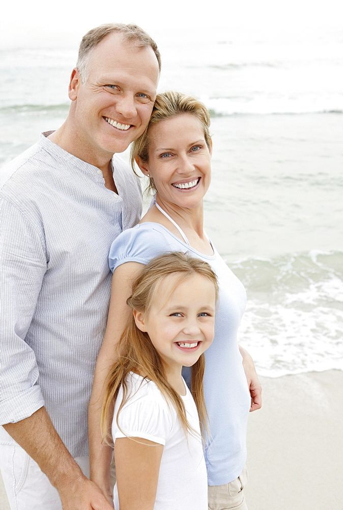 Portrait of smiling parents with daughter (10-11)