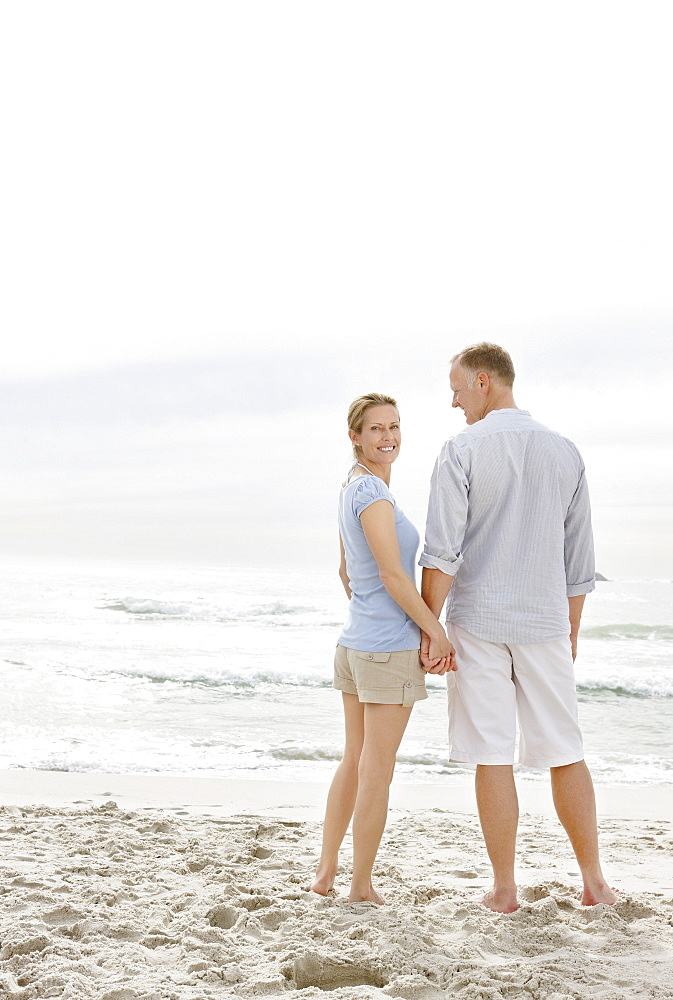 Portrait of couple standing on beach