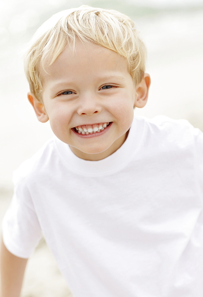 Portrait of boy (4-5) playing on beach