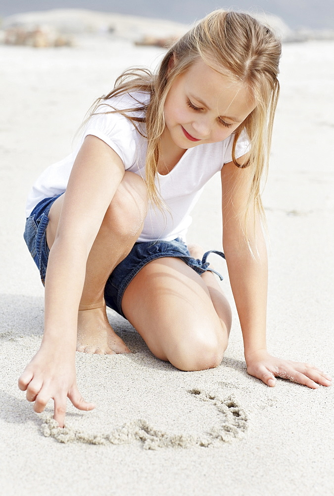 Girl (10-11) playing on beach