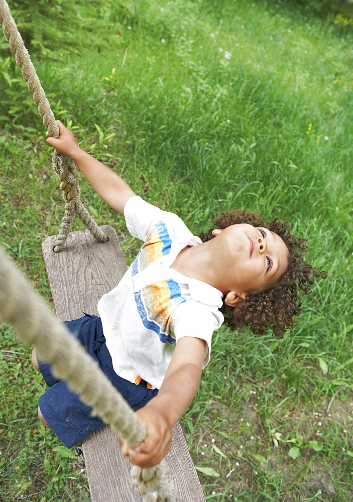 Carefree child swinging