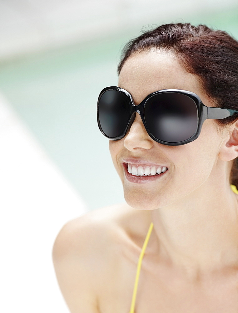 Brunette wearing large sunglasses