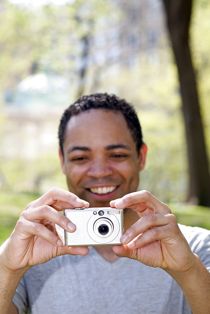Man taking photograph in Central Park