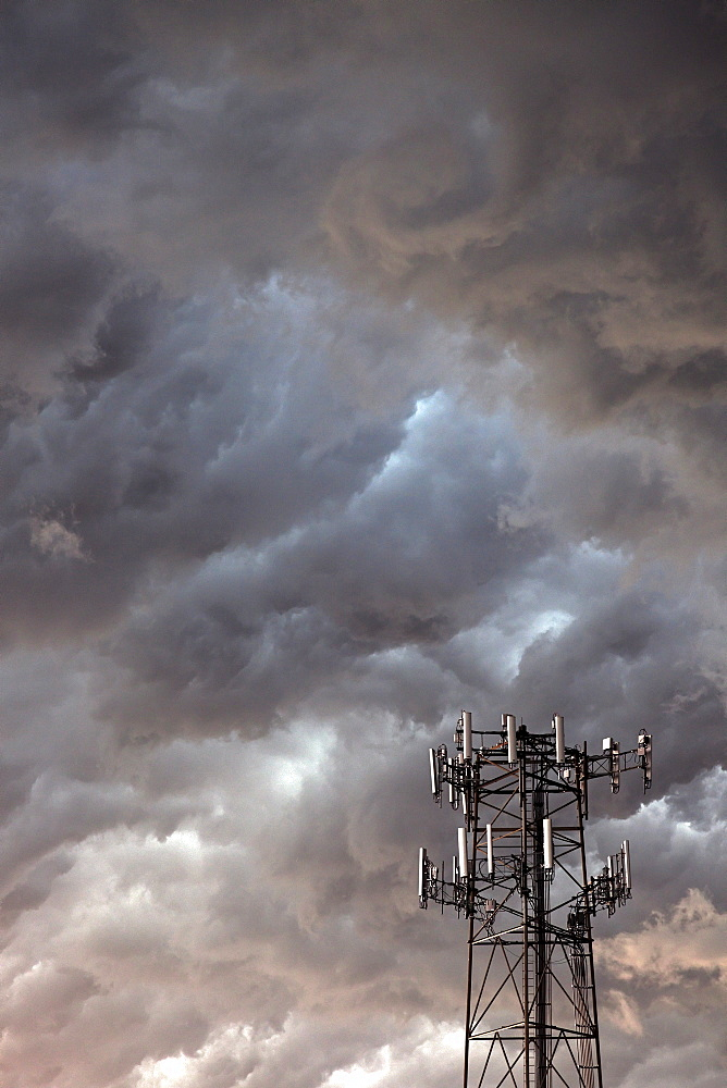 Telecommunication antenna in front of storm clouds, USA, Illinois