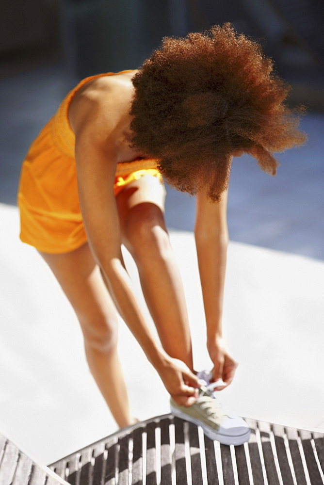 Woman tying her shoelace