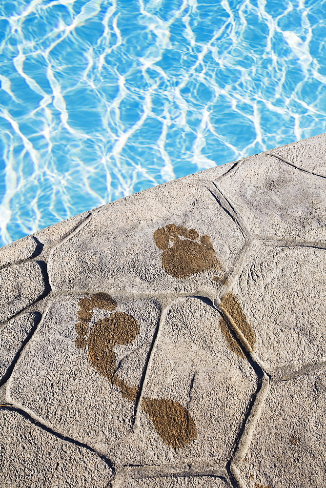 Footprints by the pool