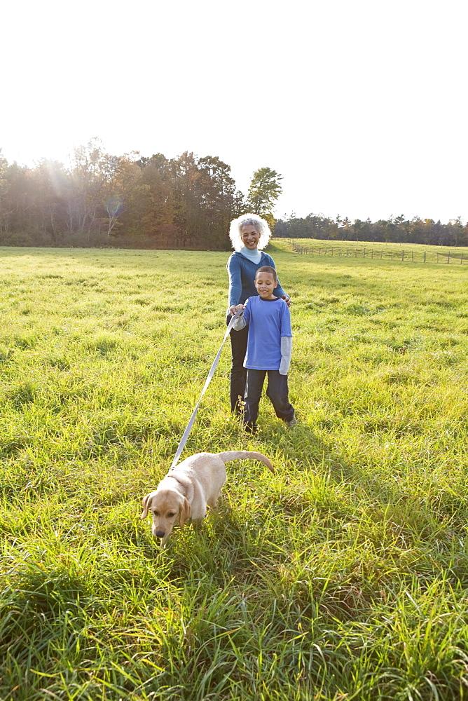Boy walking dog on a leash