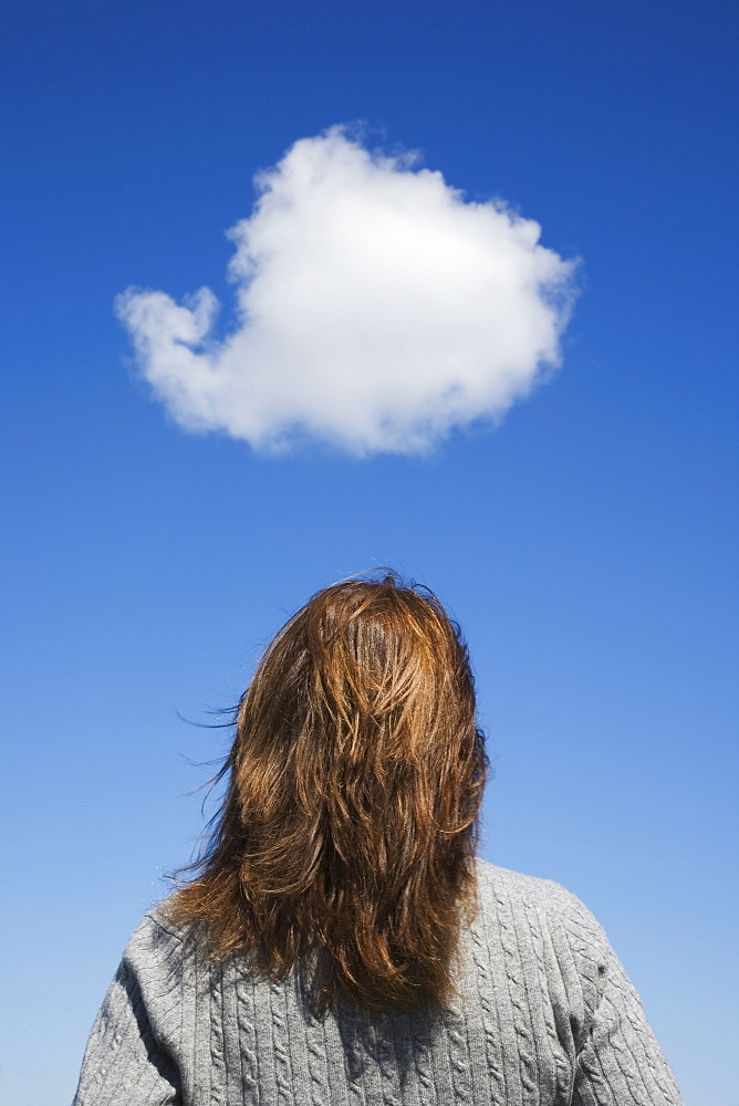 Woman looking at cloud