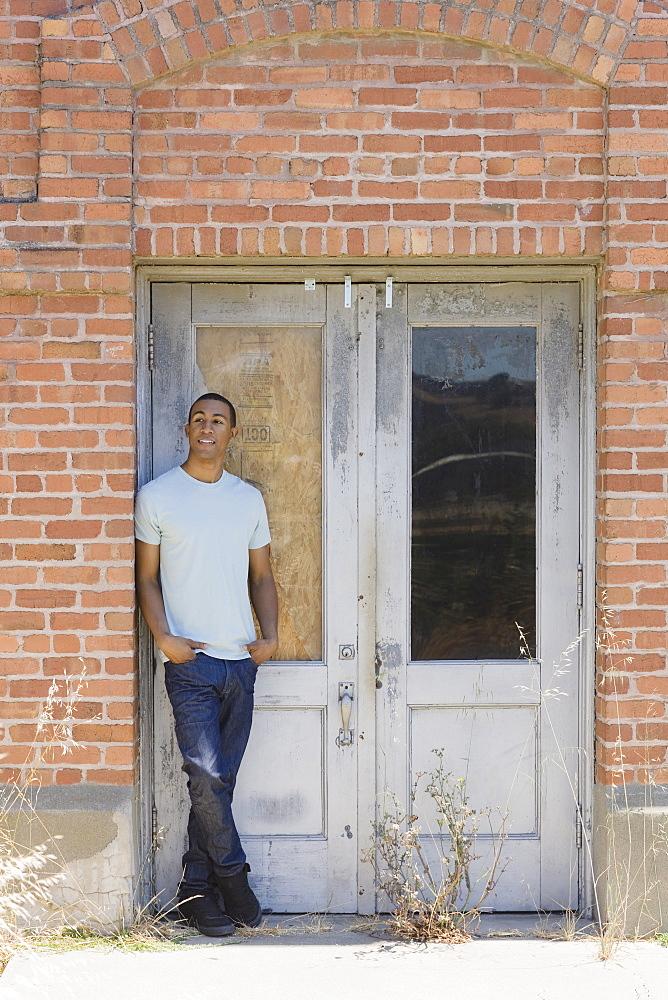 Young man at abandoned building