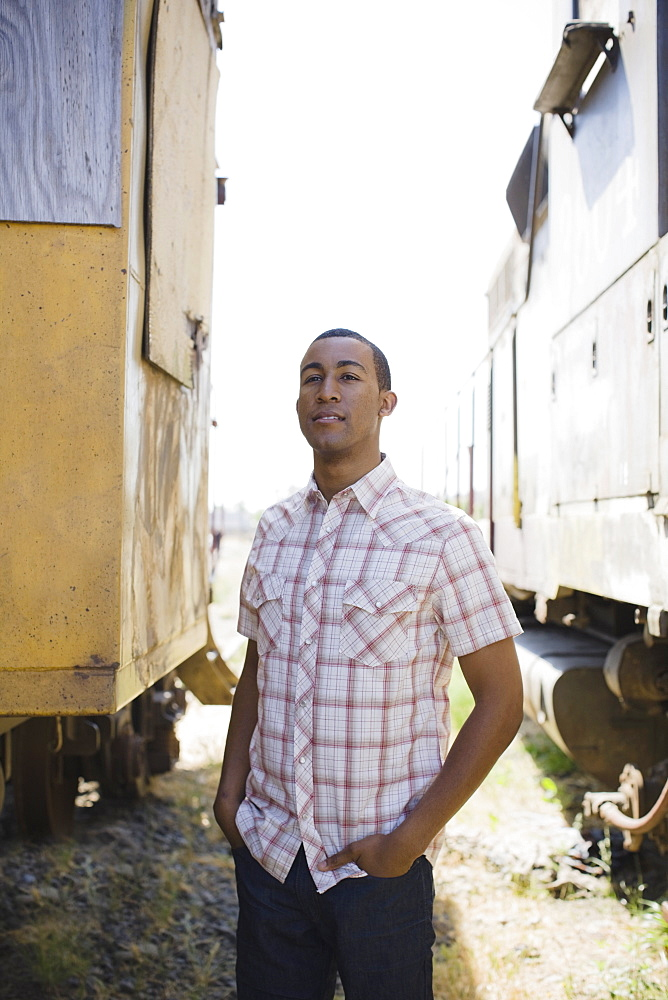 Young man beside train