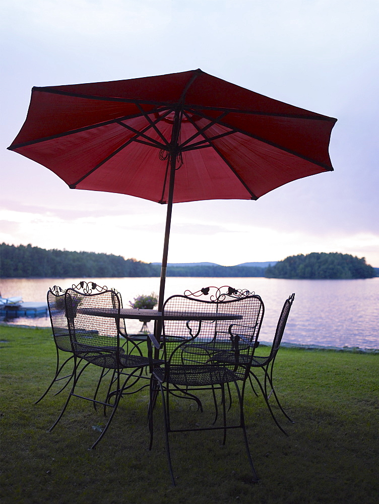 A patio set by a lake