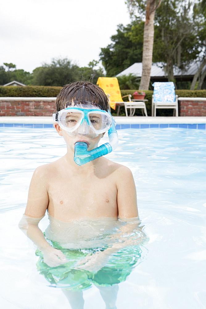 Boy snorkeling in swimming pool
