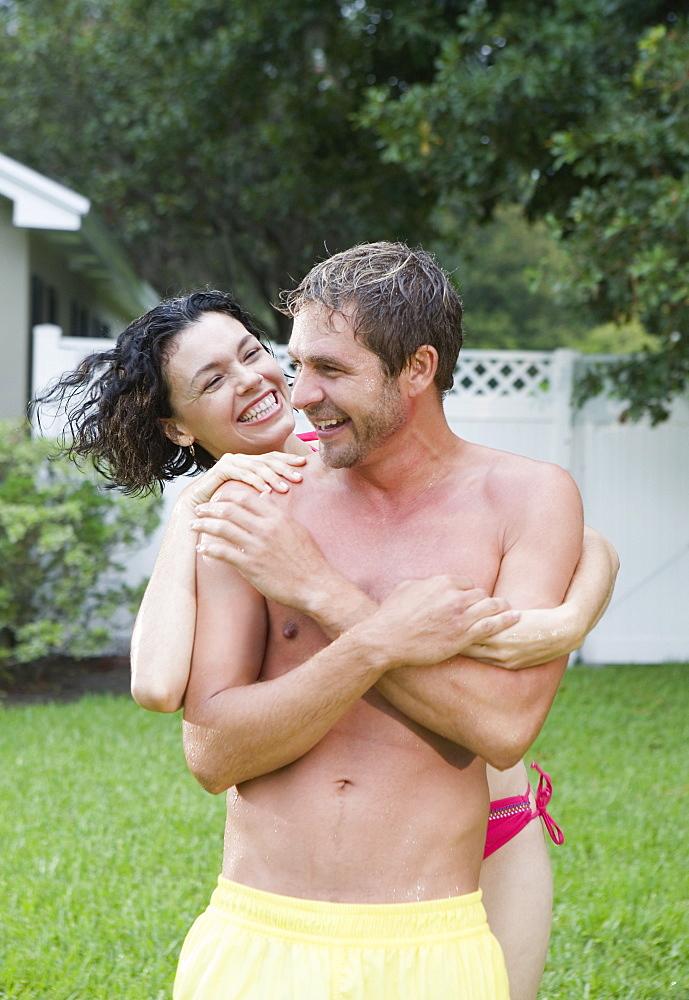 Wet couple playing backyard