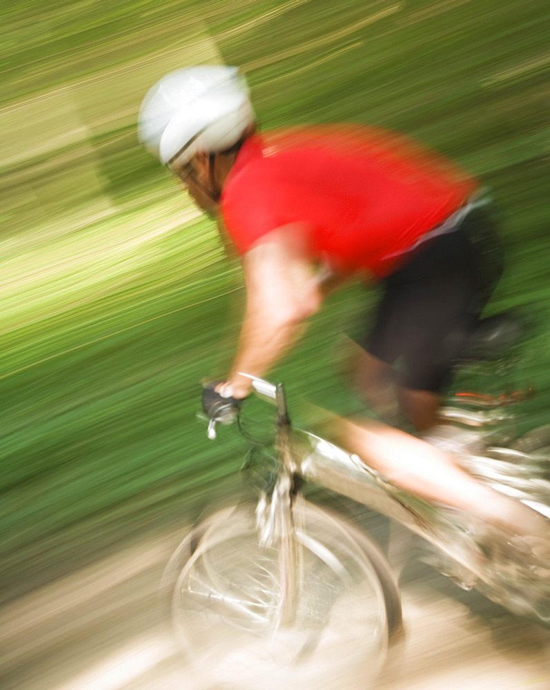 Blurred shot of man riding mountain bike