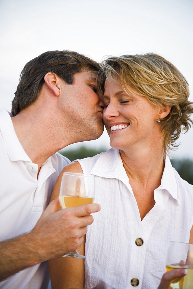 Man kissing wife's cheek