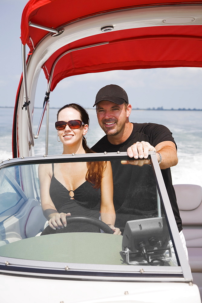 Couple driving boat, Florida, United States