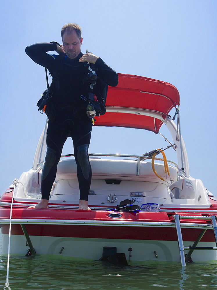 Man with scuba gear on boat, Florida, United States