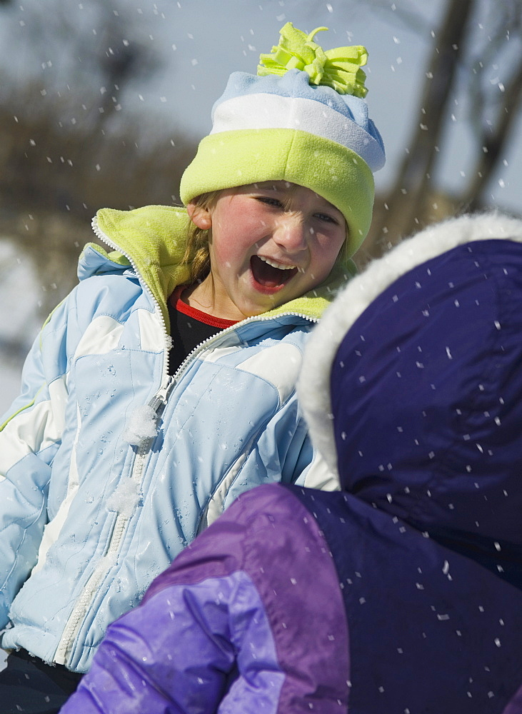Children laughing in snow