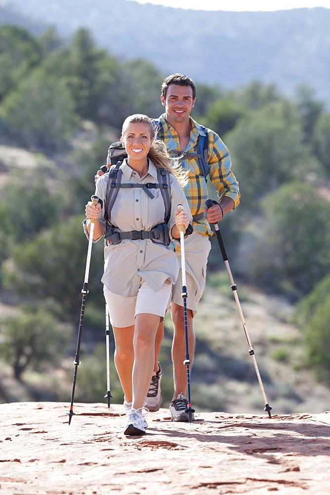 USA, Arizona, Sedona, Young couple hiking in desert