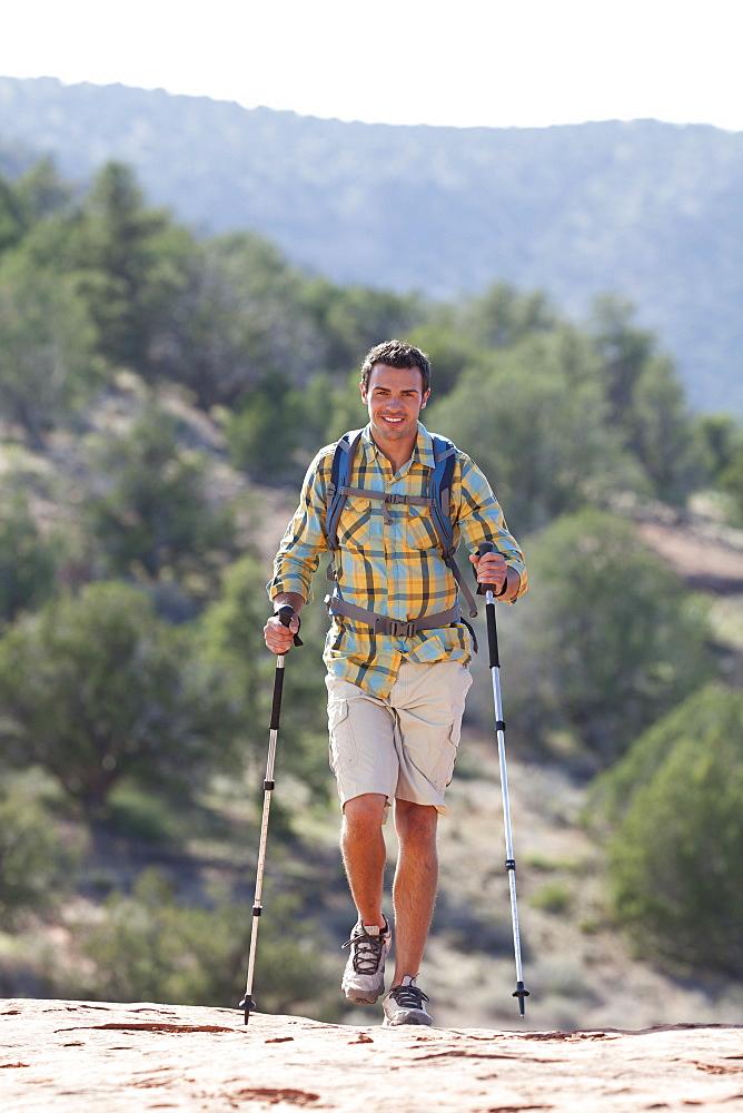 USA, Arizona, Sedona, Young man hiking in desert