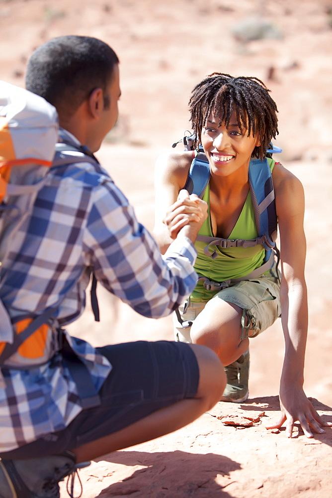 Young couple hiking and enjoying desert scenery