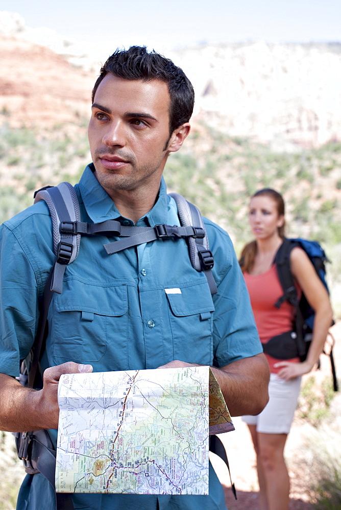 USA, Arizona, Sedona, Young couple hiking, man holding map