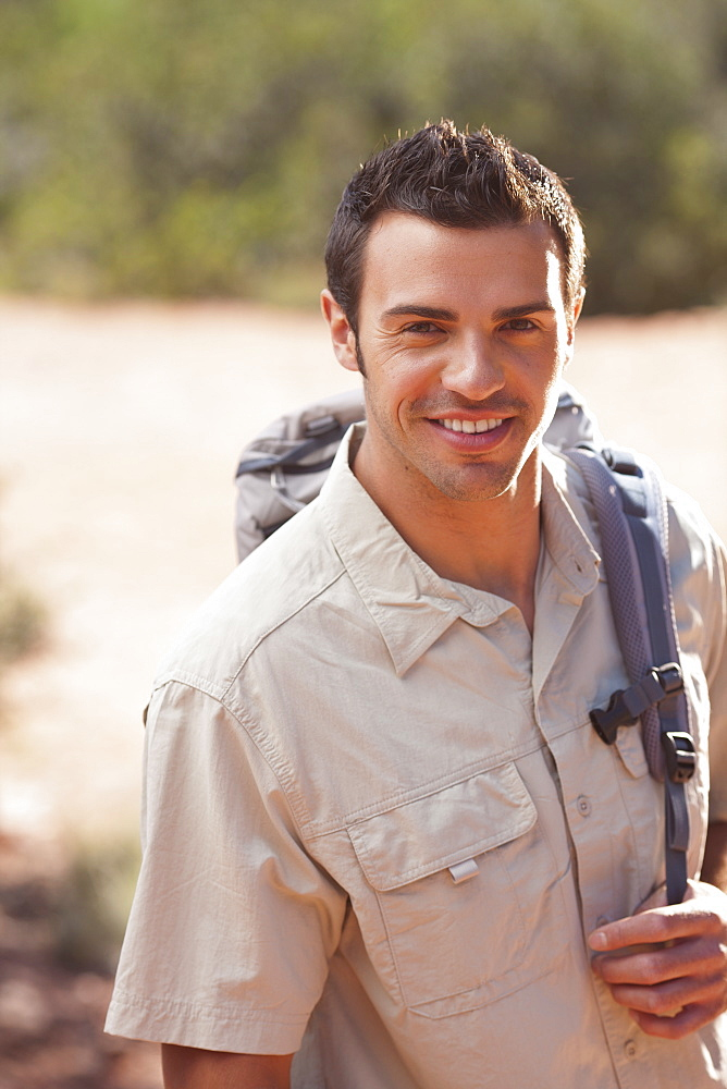 Young man hiking in desert