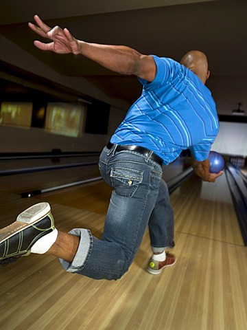 Mature man bowling