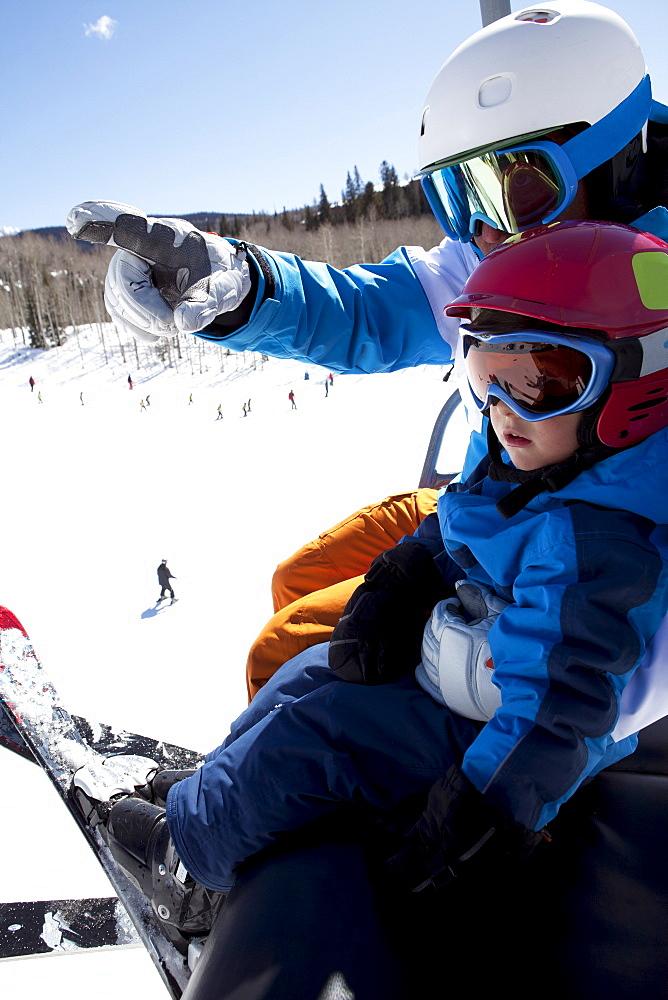 USA, Colorado, Telluride, Father with son (2-3) on ski lift