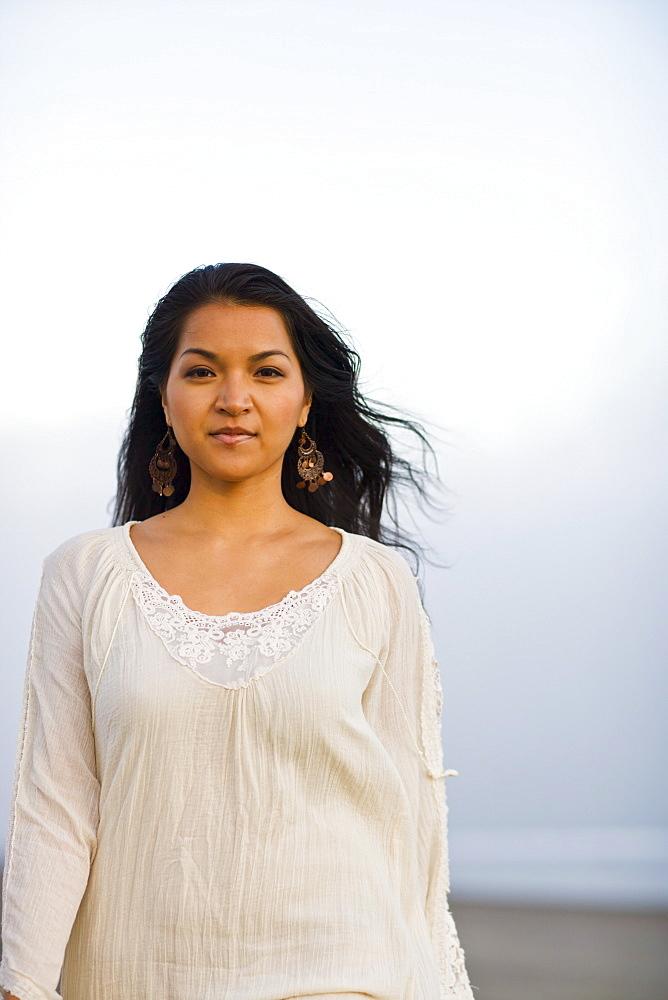 USA, California, Stinson Beach, Portrait of young woman on beach
