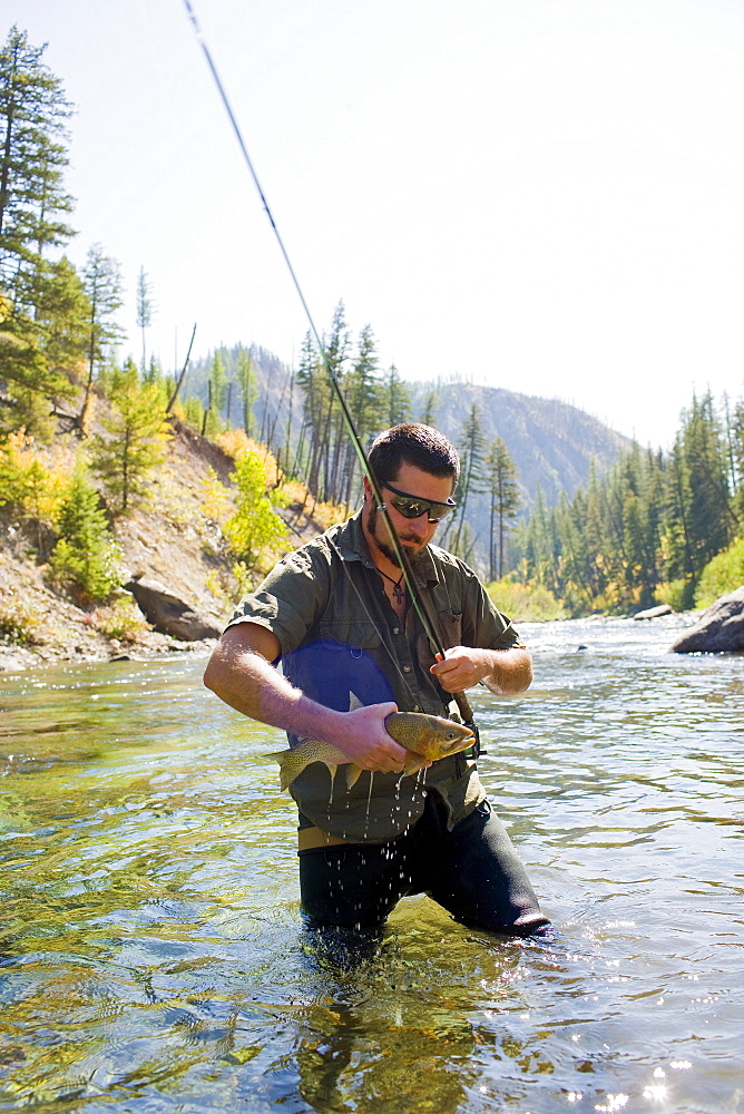 USA, Montana, Man fly fishing in North Fork of Blackfoot River