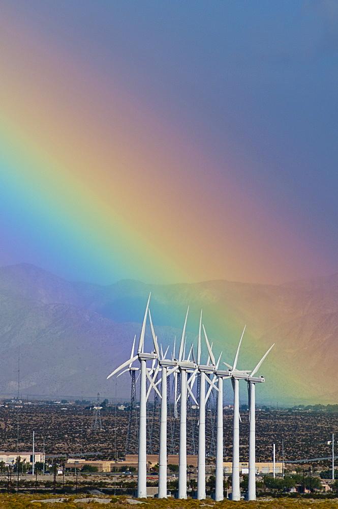 USA, California, Palm Springs, rainbow over wind turbines