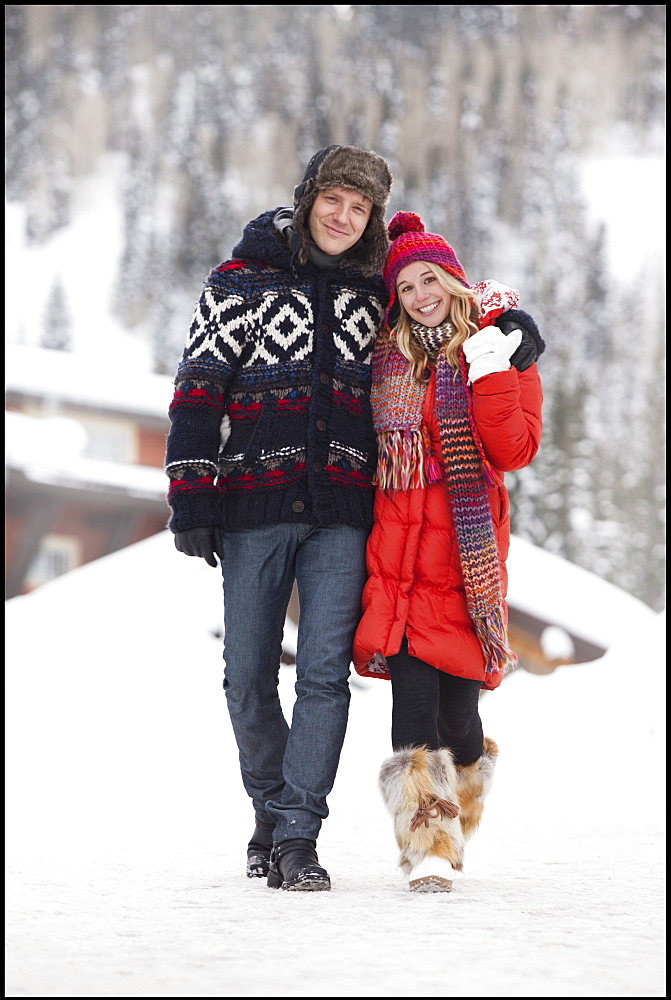 USA, Utah, Salt Lake City, Portrait of young couple walking in snow