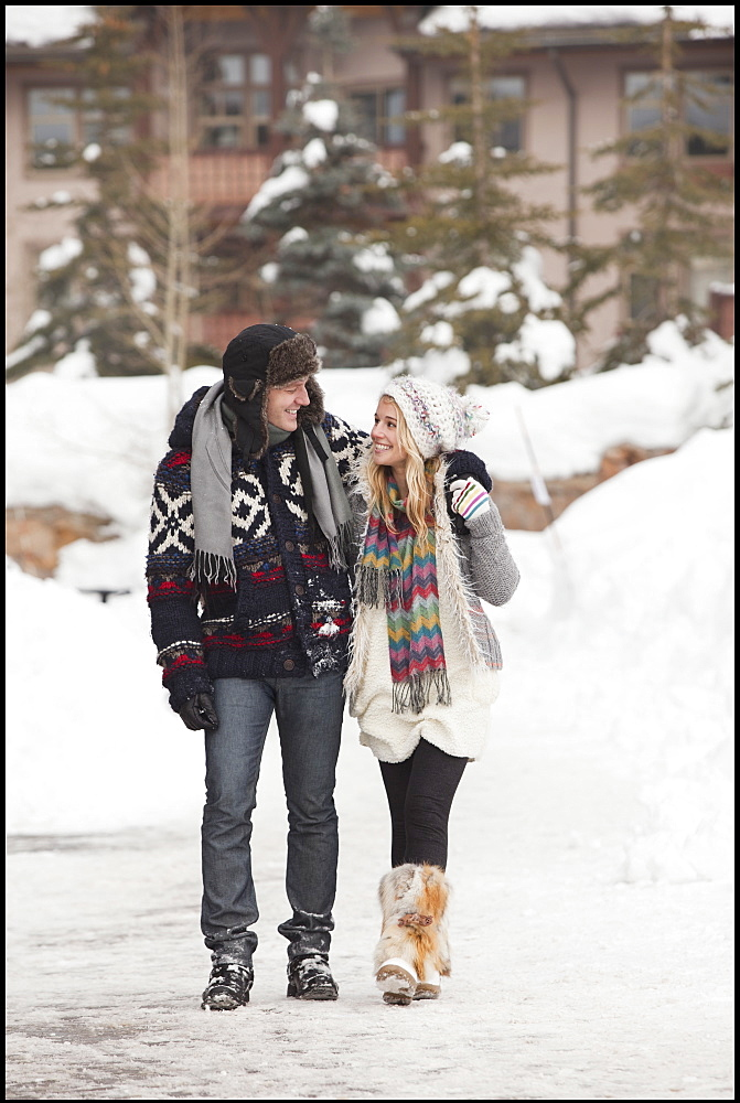 USA, Utah, Salt Lake City, couple walking in snowy village