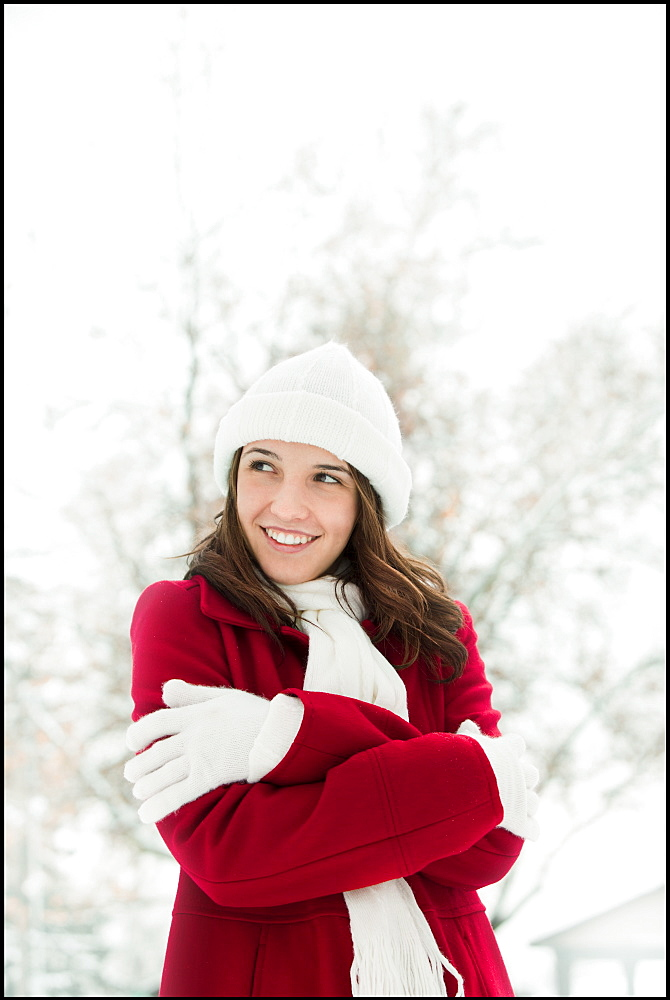USA, Utah, Lehi, Young woman shivering in snow