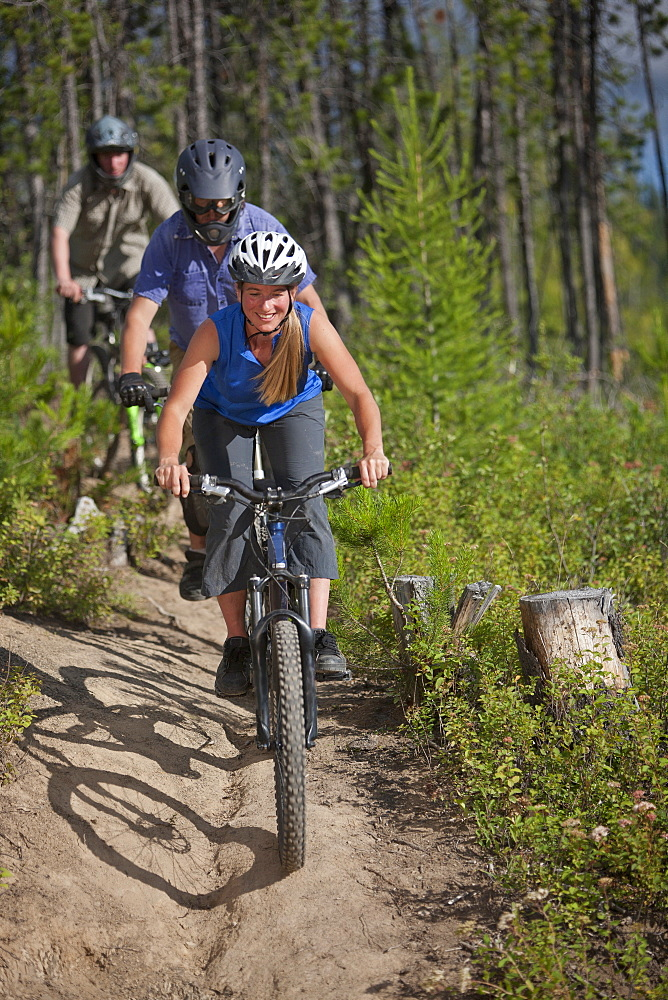 Canada, British Columbia, Fernie, Group of three people enjoying mountain biking