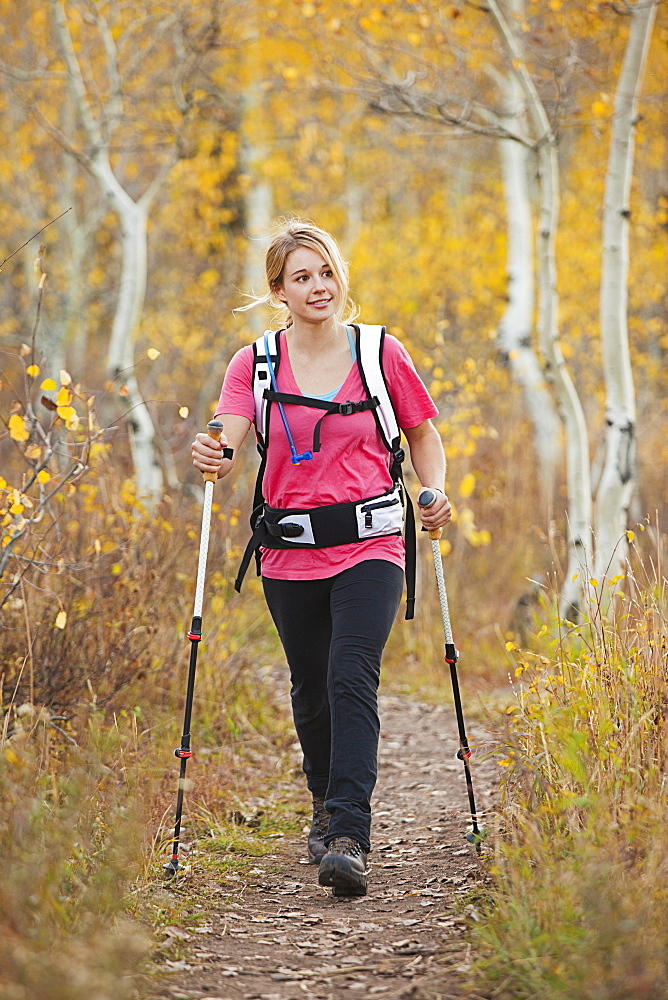 USA, Utah, young woman walking on trail