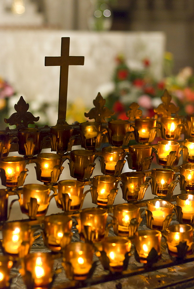Cross with candles in cathedral