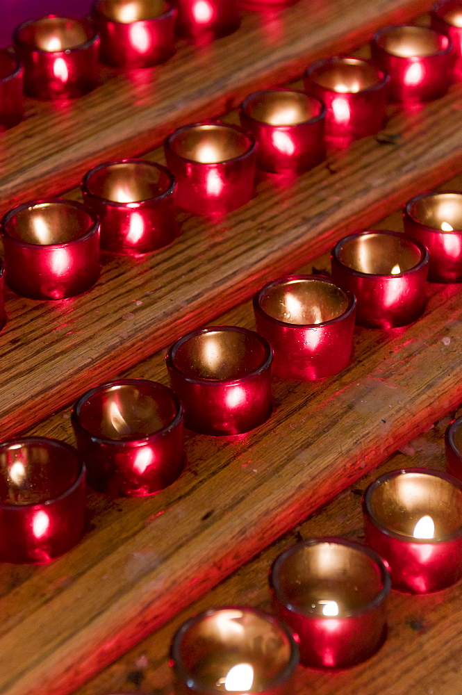 Rows of candles in cathedral