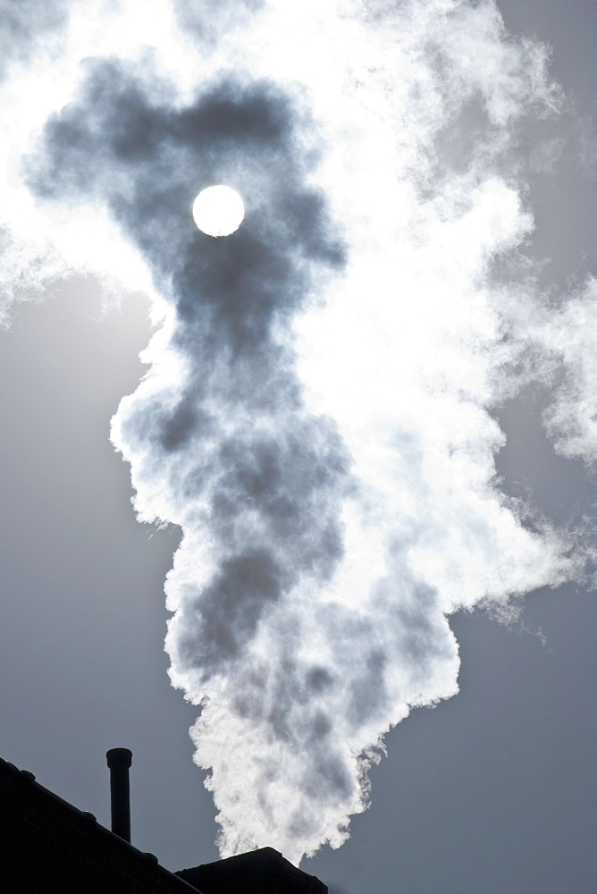 Smoke coming out of factory chimney